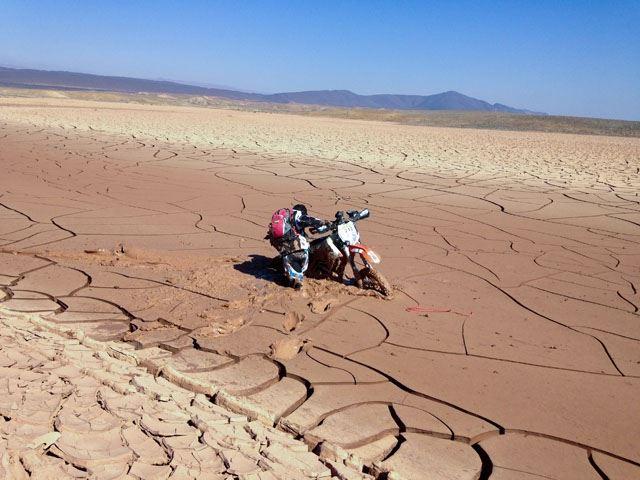 Moto having trouble in wet sand