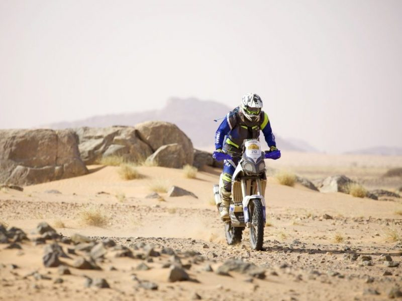 Moto rider in the Moroccan desert in the real way to dakar